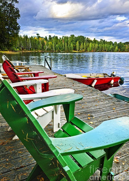 Adirondack Chairs Greeting Card featuring the photograph Deck Chairs On Dock At Lake by Elena Elisseeva