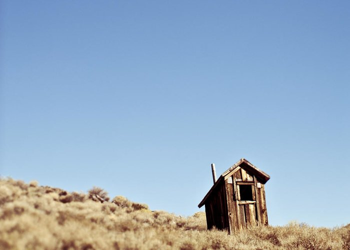Abandoned Greeting Card featuring the photograph Dilapidated Outhouse On Hillside by Eddy Joaquim