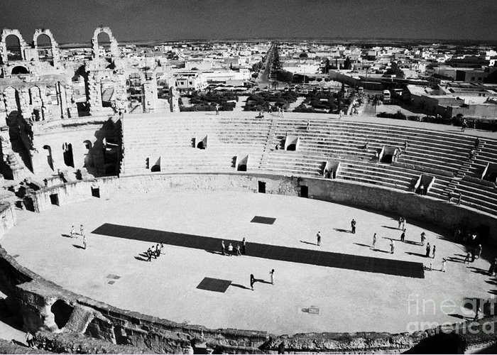 Tunisia Greeting Card featuring the photograph distant straight roman road leading through el Djem towards tourists the old roman colloseum arena by Joe Fox