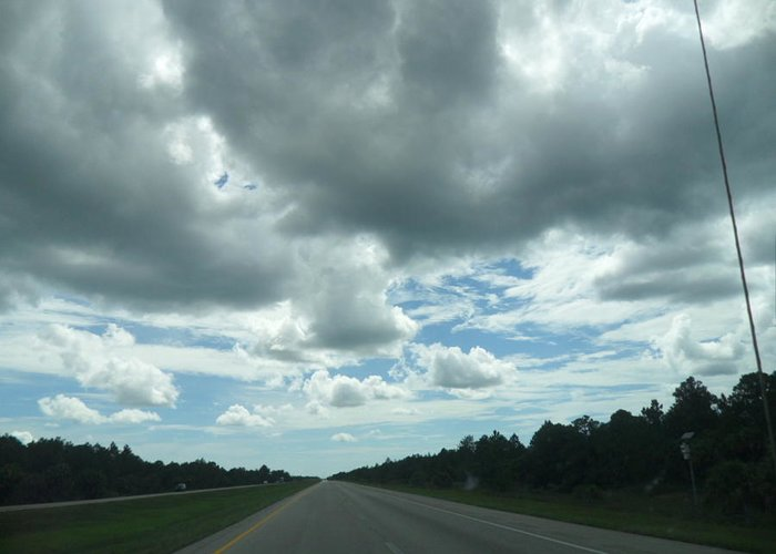 Sky Greeting Card featuring the photograph Driving Through The Clouds by Val Oconnor