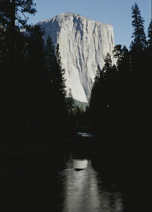 North America Greeting Card featuring the photograph El Capitan Soars Above The Merced River by Marc Moritsch