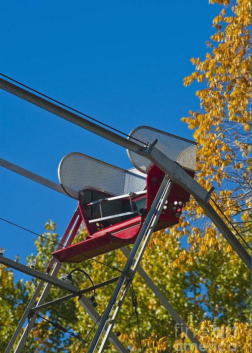 Amusement Greeting Card featuring the photograph Empty Chair On Ferris Wheel by Thom Gourley/Flatbread Images, LLC