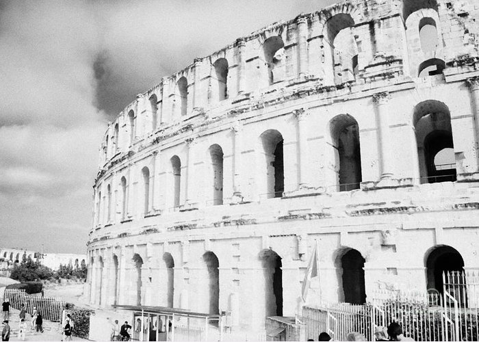 Tunisia Greeting Card featuring the photograph Entrance And Front Of The The Old Roman Colloseum Against Blue Cloudy Sky El Jem Tunisia by Joe Fox