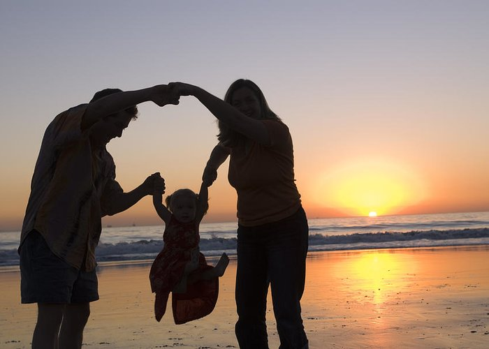 Three People Greeting Card featuring the photograph Family Portrait On The Beach At Sunset by Rich Reid