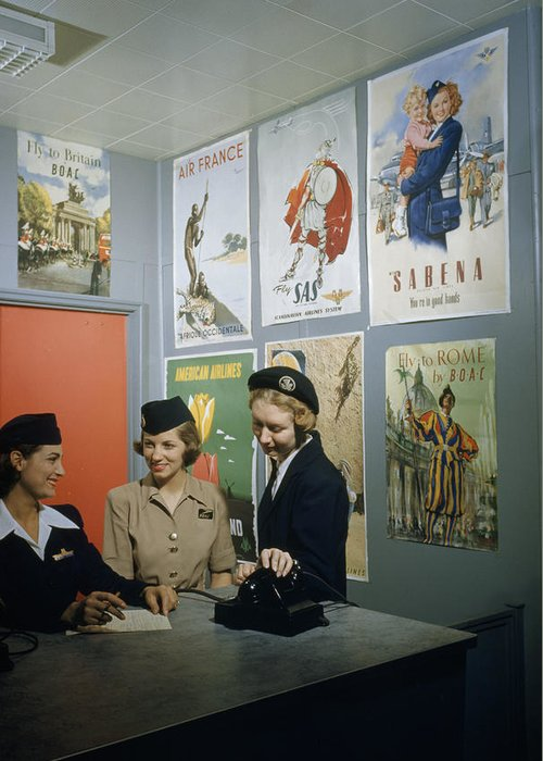 Indoors Greeting Card featuring the photograph Flight Attendants Stand And Talk by B. Anthony Stewart
