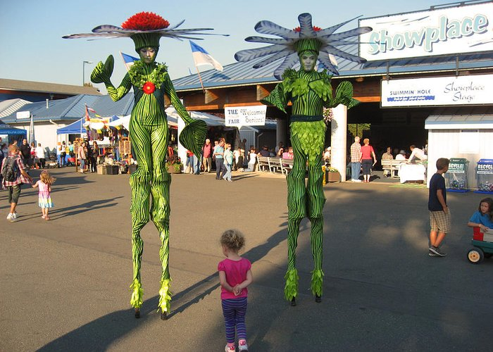 People On Stilts Greeting Card featuring the photograph Flower Fairies At The Fair by Kym Backland