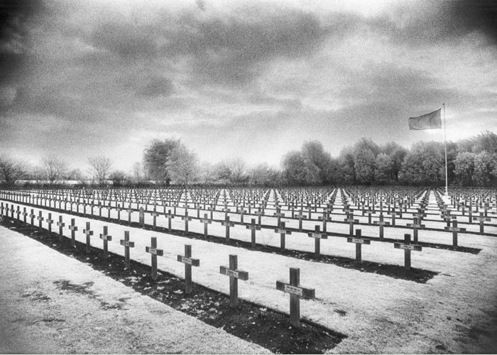 Graves; Graveyard; Gravestones; Belgian; Landscape; Flag; War Memorial; Commemorative; Crosses; Mysterious; Eerie; Atmospheric; Rows; Ominous; Overcast; Great; Wwi; Ww1; One; 1st Greeting Card featuring the photograph French Cemetery by Simon Marsden