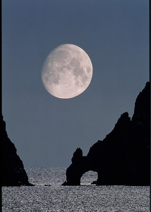 Moon Greeting Card featuring the photograph Gibbous Moon Rising Over A Coastal Cliff by David Nunuk