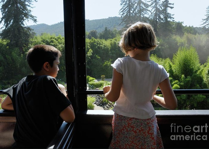 Train Greeting Card featuring the photograph Girl And Boy Looking Out Of Train Window by Sami Sarkis