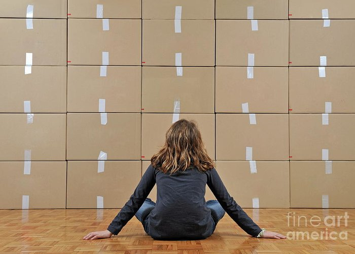 Facing Greeting Card featuring the photograph Girl Seated In Front Of Cardboard Boxes by Sami Sarkis