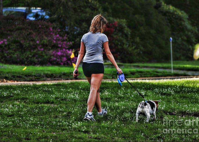 Girl Walking Dog Greeting Card featuring the photograph Girl Walking Dog by Paul Ward