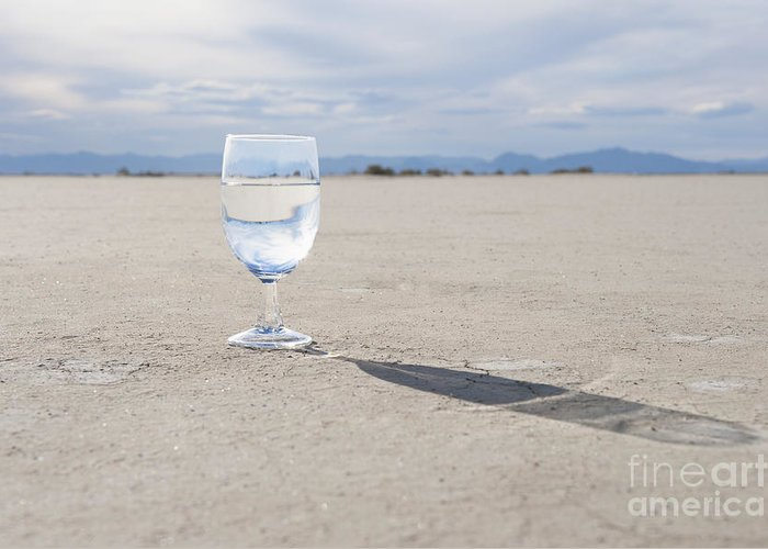 Arc Greeting Card featuring the photograph Glass Of Water On Dried Mud by Thom Gourley/Flatbread Images, LLC