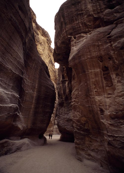 Outdoors Greeting Card featuring the photograph Hikers In The Siq Canyon Leading by Gordon Wiltsie