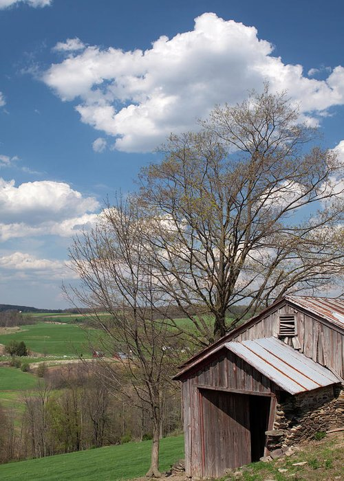 Tin Greeting Card featuring the photograph Hillside Weathered Barn Dramatic Spring Sky by John Stephens