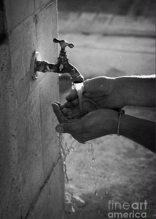 Man Greeting Card featuring the photograph Hispanic Man Cupping Water And Washing Hands At Outdoor Tap by Joe Fox