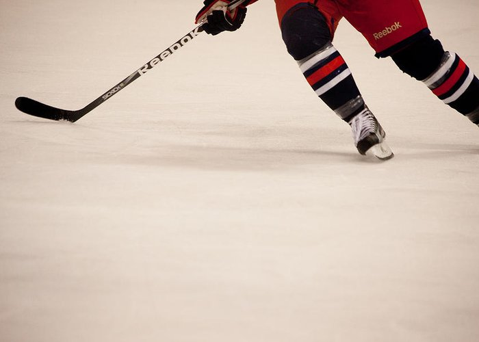 Hockey Greeting Card featuring the photograph Hockey Stride by Karol Livote
