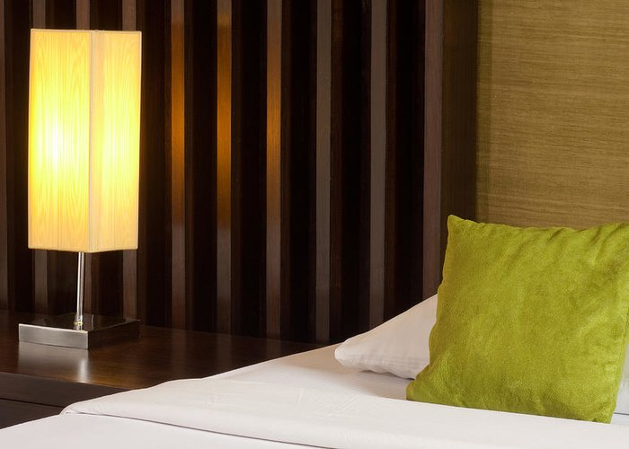 Hotel Greeting Card featuring the photograph Lamp And Bed by Atiketta Sangasaeng