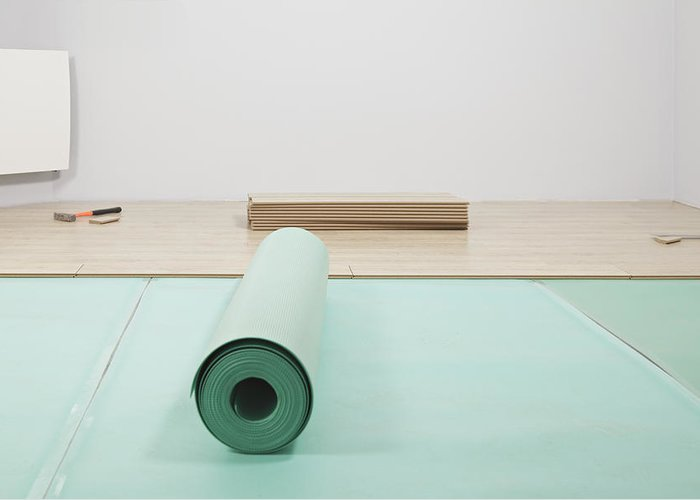 Nobody Greeting Card featuring the photograph Laying A Floor. A Roll Of Underlay Or by Magomed Magomedagaev