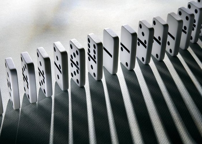 Cause And Effect Greeting Card featuring the photograph Lined Up Dominoes by Victor De Schwanberg