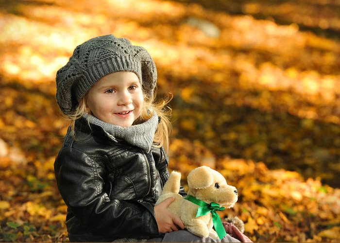 Adorable Greeting Card featuring the photograph Little Girl In Autumn Leaves by Waldek Dabrowski