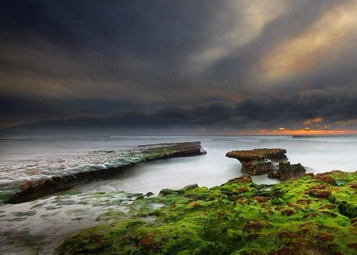 Greeting Card featuring the photograph Long Exposure Of A Stormy Sunset At A by Larry Marshall