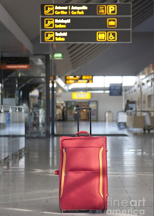 Abandoned Greeting Card featuring the photograph Luggage Sitting Alone In An Airport Terminal by Jaak Nilson