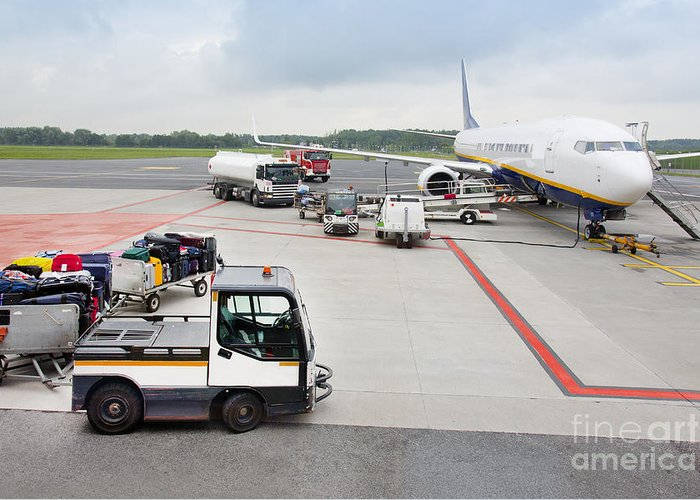 Air Travel Greeting Card featuring the photograph Luggage Transported To An Airprot by Jaak Nilson