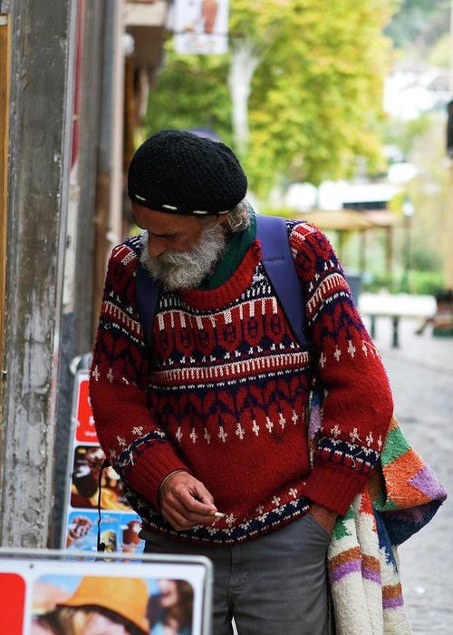 Granada Greeting Card featuring the photograph Man In A Red Sweater by Lorraine Devon Wilke
