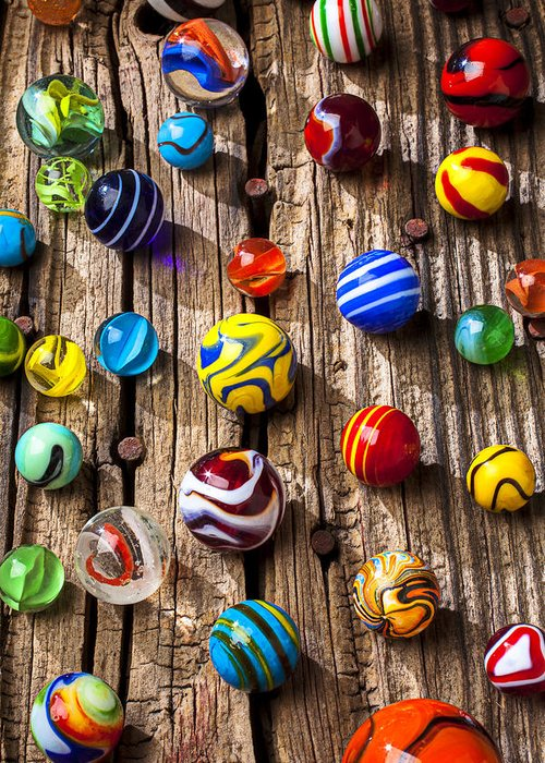 Marbles Greeting Card featuring the photograph Marbles On Wooden Board by Garry Gay