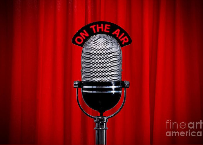 Microphone Greeting Card featuring the photograph Microphone On Stage With Spotlight On Red Curtain by Richard Thomas