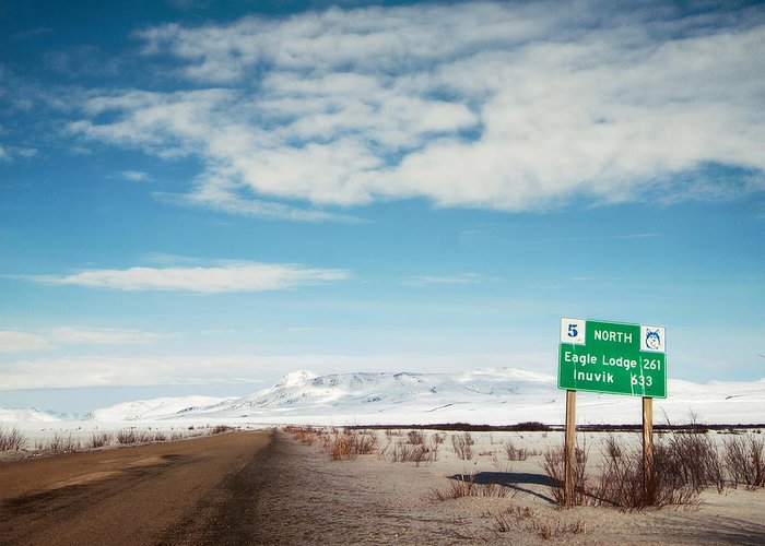 Territories Greeting Card featuring the photograph Milepost At The Dempster Highway by Priska Wettstein