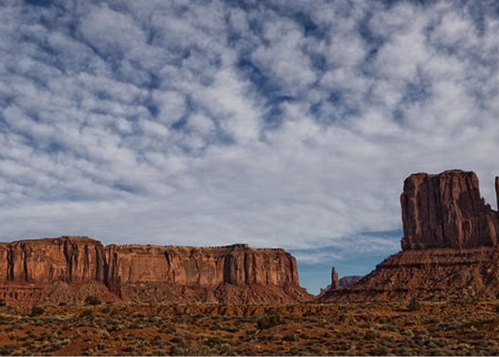 Light Greeting Card featuring the photograph Morning Clouds Over Monument Valley by Robert Postma