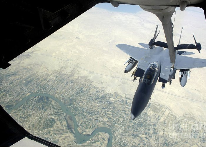 Horizontal Greeting Card featuring the photograph N F-15e Strike Eagle Receives Fuel by Stocktrek Images