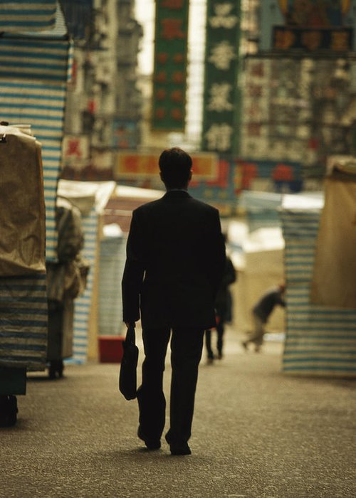 Asia Greeting Card featuring the photograph Office Worker With A Briefcase Walks by Justin Guariglia