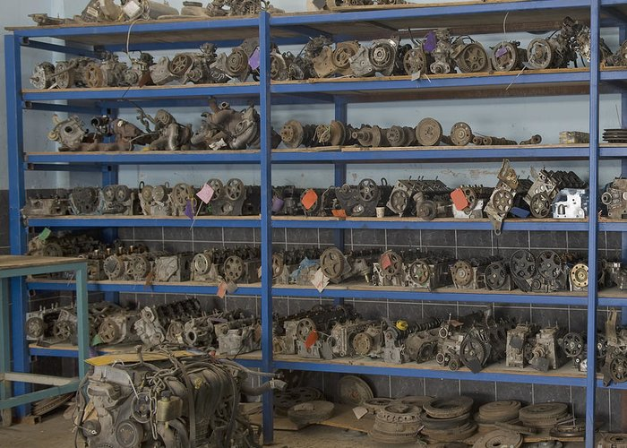 Auto Greeting Card featuring the photograph Old Automobile Parts On Shelves by Noam Armonn