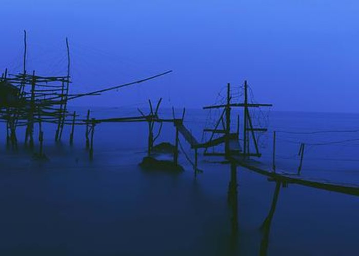 Water Greeting Card featuring the photograph Old Fishing Platform Over Water At Dusk by Axiom Photographic