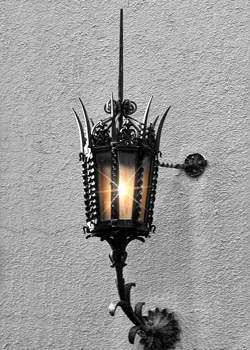 Lighting Greeting Card featuring the photograph Outdoor Wall Lamp Aglow by Linda Phelps