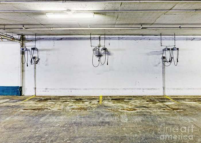 Basement Greeting Card featuring the photograph Parking Garage With Charging Stalls by Skip Nall