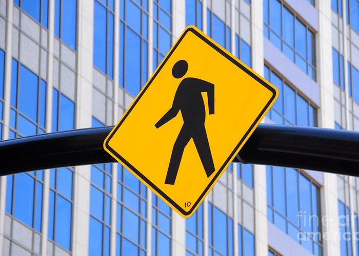 Pedestrian Greeting Card featuring the photograph Pedestrian Crosswalk Sign In Business District by Gary Whitton