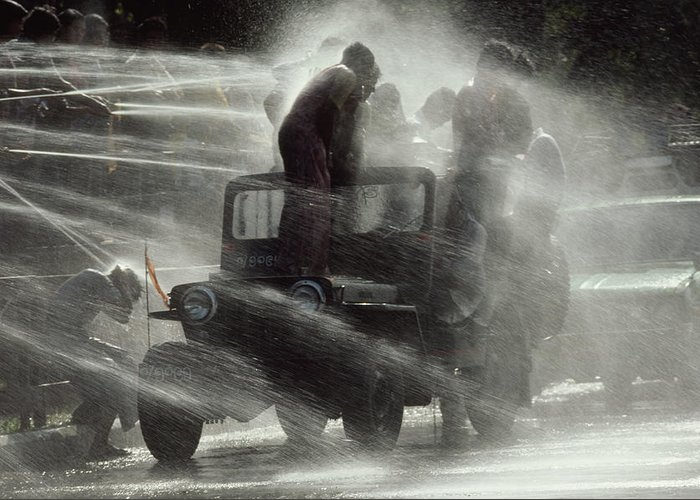 Outdoors Greeting Card featuring the photograph People Are Sprayed At The Water by James L. Stanfield