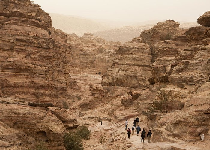 Petra Greeting Card featuring the photograph People Walk Along A Path by Taylor S. Kennedy