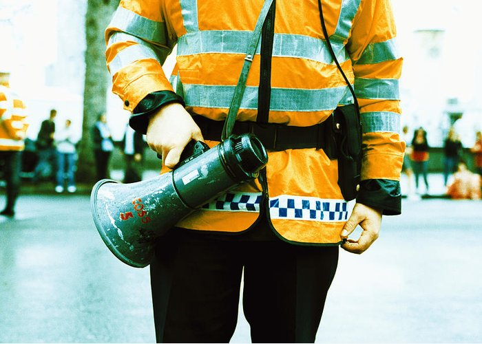 Megaphone Greeting Card featuring the photograph Police Officer by Kevin Curtis