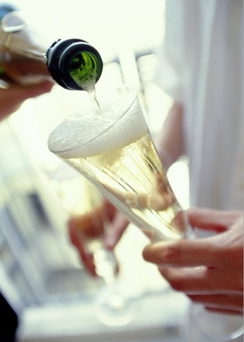 Champagne Greeting Card featuring the photograph Pouring Champagne by David Munns