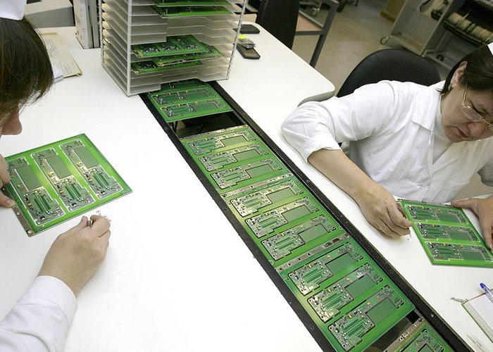 Electronic Circuit Greeting Card featuring the photograph Printed Circuit Board Assembly Work by Ria Novosti