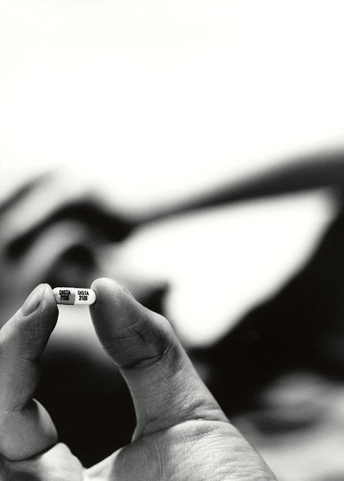 Drug Greeting Card featuring the photograph Prozac Antidepressant Capsule by Cristina Pedrazzini