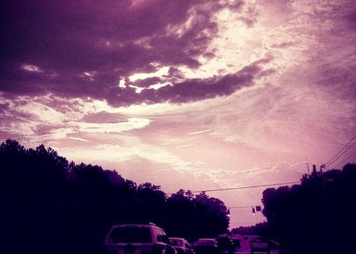 Cloudscape Greeting Card featuring the photograph #purple #sky #clouds #driving by Katie Williams