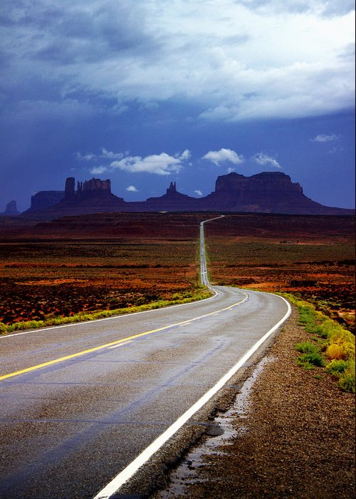 Monument Valley Greeting Card featuring the photograph Rainclouds Over Monument Valley by Ellen Heaverlo