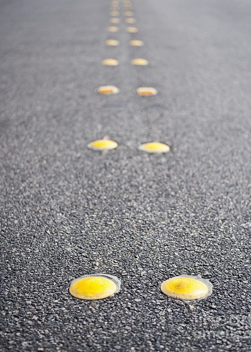 Asphalt Greeting Card featuring the photograph Reflective Roadway Divider Bumps by Thom Gourley/Flatbread Images, LLC