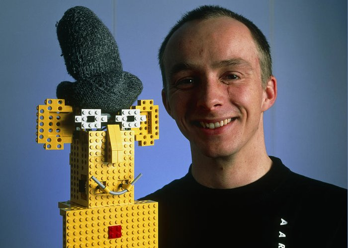 Robot Greeting Card featuring the photograph Researcher With His Happy Emotional Lego Robot by Volker Steger