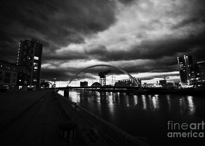 Clyde Greeting Card featuring the photograph riverside walkway by the Clyde Arc bridge over the river clyde at dusk in Glasgow Scotland UK by Joe Fox